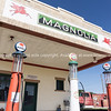 Mobilgas petrol pump at Magnolia Gas Station in Shamrock, Texas. Old Shamrock Fire Dept No 5 truck in background.