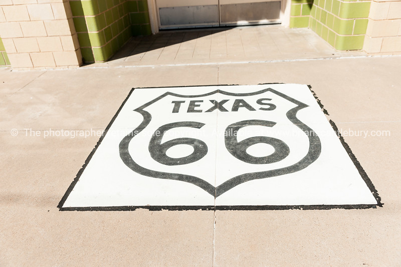 Pavement Route 66 sign, U Drop Inn, Shamrock, Texas, USA.  one of the incredible variety of 66 signs seen along the historic route