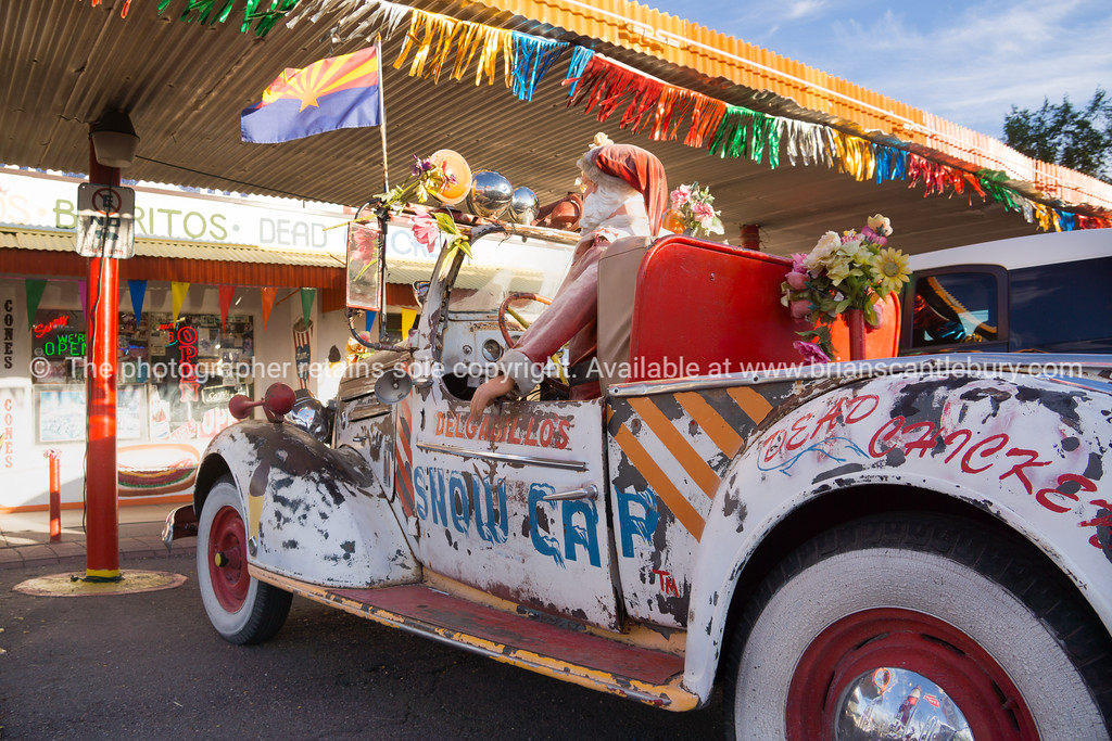 Santa in old truck outside Route 66 Delgardillo's Snow Cap restaurant in Seligman, Arizona USA.