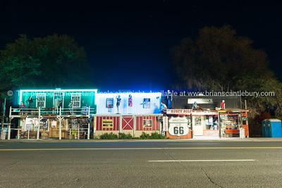 Route 66 through Seligman,Arizona, USA. Manikins over store verandas.