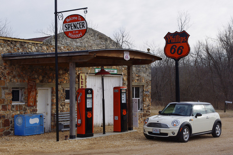 The old filling station and garage at Spencer, Missouri, now under restoration. <br /> <br /> Just up the road to the east, old Route 66 crosses Johnson Creek via a steel truss bridge.