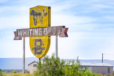 Another weathered sign for the abandoned Whiting Bros gas station and motel still stands along Route 66 near San Fidel, New Mexico