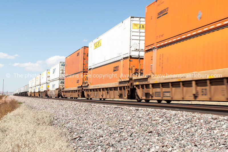 Mile long trains rumble through the New Mexico landscape alongside Historic Route 66, New Mexico, USA.