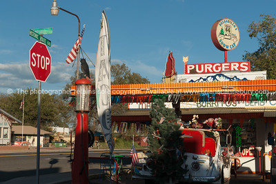 Christmas tree on  old truck outside Route 66 Delgardillo's Snow Cap restaurant in Seligman, Arizona USA.dng