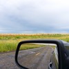 Cornfields of Texas ahead and in rear view mirror.