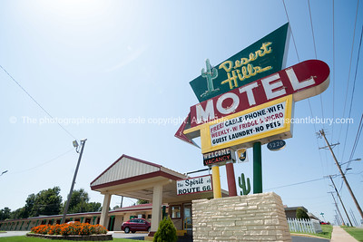 Famous retro style, complete with a neon cactus on the motel's kitschy sign, the Desert Hills Motel,buidlings and street scenes Tulsa, Oklahoma on Route 66