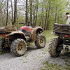 Muddy ATV's at the end of the day and some muddy people!