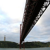 Lisbon - the ship going under a bridge