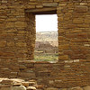 A window frames distant ruins