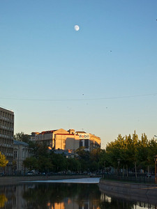 Dâmbovița River in Bucharest, with moon.