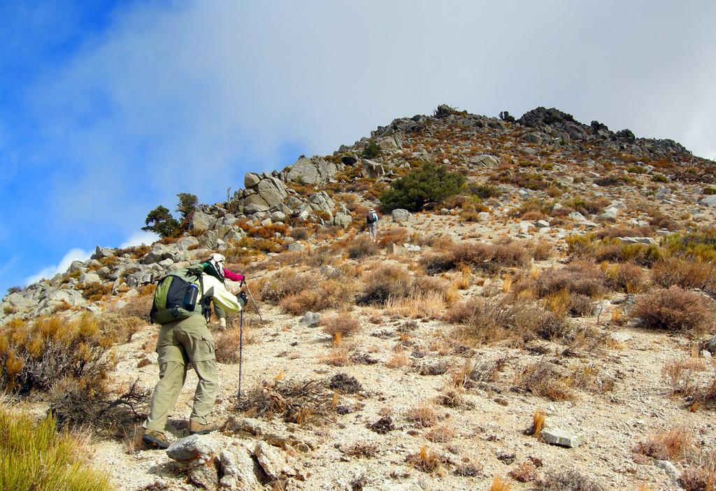 Battling wind 50 mph wind gusts, we bravely hike upwards.