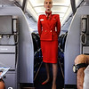Loved the retro Aeroflot Stewardess (Panam) style outfits (sorry about the blur - she gave me a high sign not to try again!).  They have little red hats they were cocked on their heads when boarding.