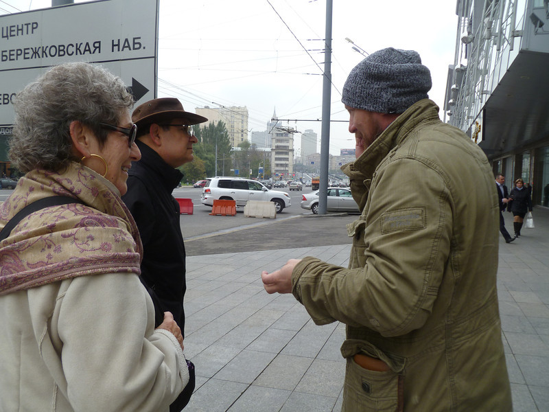 Asking directions on the street.  This man didn't speak good English so he called his 16 year old son and told him in Russian what we wanted, then the son told us in perfect English what we needed to know.