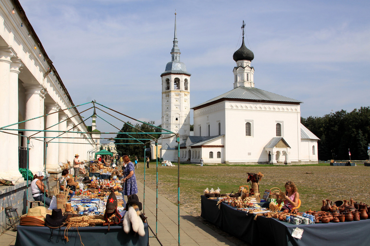 Suzdal - Resurrection Church and Trade (or Market) Square (Russian name, Torgovaya Pl), with open-air trading stalls.