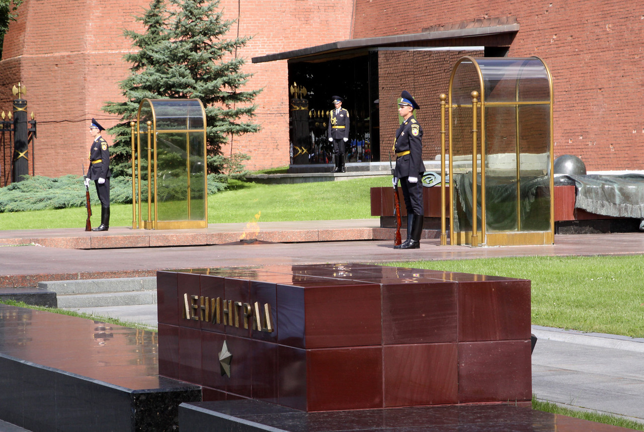 The Tomb of the Unknown Soldier and Eternal Flame.  The tomb contains the remains of a soldier who died in 1941 at km41 of Leningradskoe sh which was the closest the Nazis came to Moscow.  The large block/plaques in front of the tomb honour the Soviet 'hero' cities of WWII.