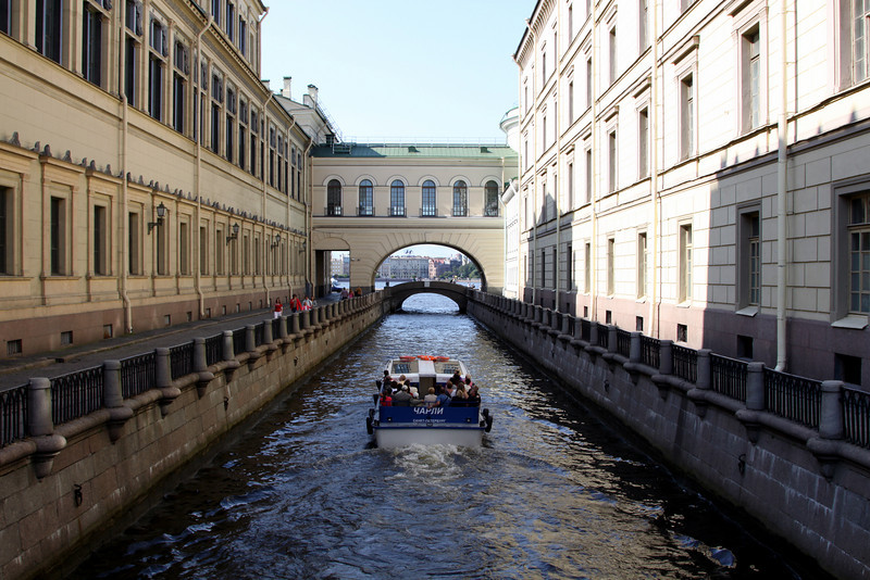 Canal between the Large (or New) Hermitage (on left) and the Hermitage State Theatre (on right).  The building over the canal is the State Theatre foyer which joins the Hermitage to the theatre.  The canal flows into the Neva river in the background.