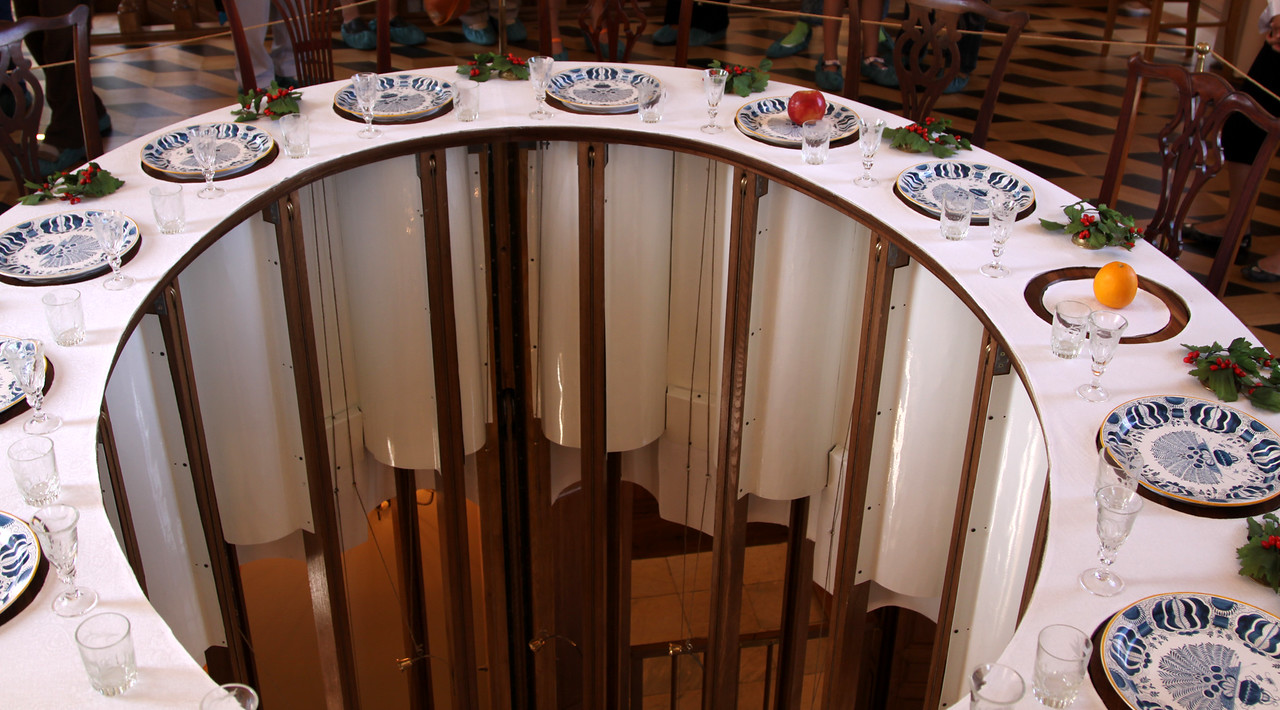 Petrodvorets (or Peterhof) Palace - A close up view of the dining table in the Hermitage.  As well as th elarge central elevator, small elevators under each plate (the white tubes) can deliver food to each diner individually.