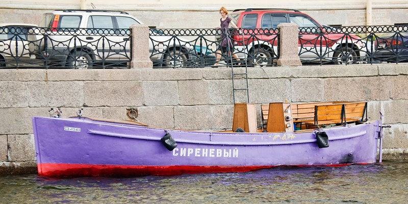 Colorful boat in city canal.