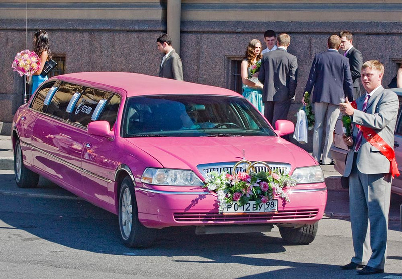Wedding Limo In front of Marriage Hall. Ready to share champagne with the limo's flowers.