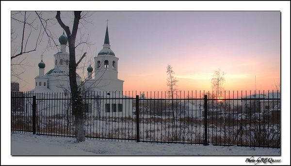The Sviato-Troitsky (Holy Trinity) Russian Orthodox church near Gorky Park, Ulan-Ude, at dusk.