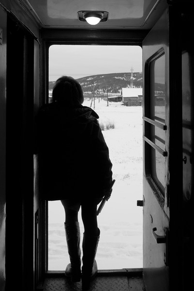 One of the trans-sib carriage attendants waits for passengers to board the train at a small village stop in Eastern Siberia.