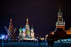 Red Square at night with a huge christmas tree being decorated.