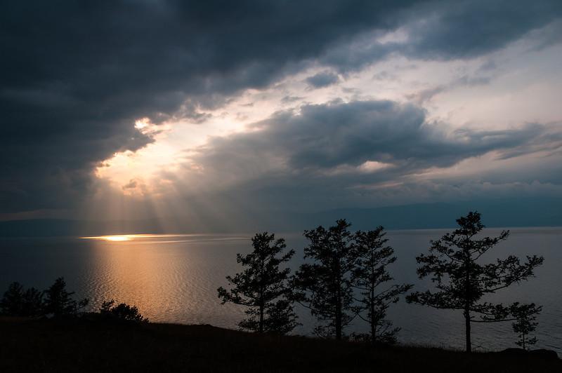 A near glimpse of the sun over Lake Baikal. Olkhon Island, Siberia - Russia