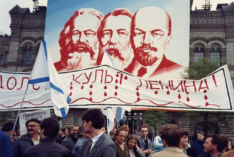 """May Day 1990.  The sign reads """"Down with the Cult of Lenin!"""""""