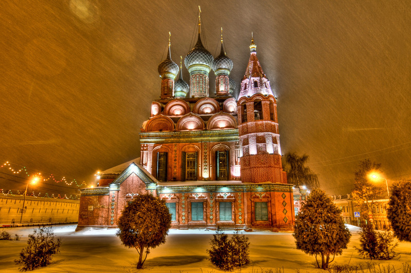 Medieval Epiphany Church in Yaroslavl during a winter storm at night.