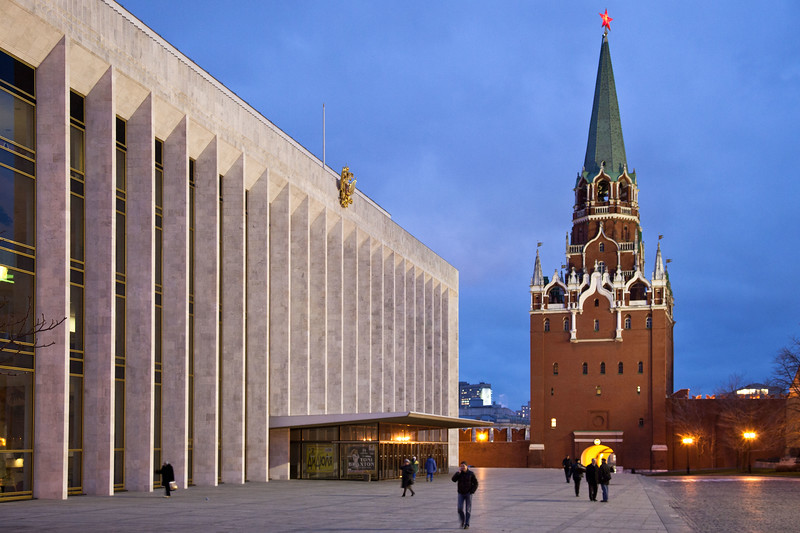 A government building inside the Kremlin and one of the towers that are part of the outer wall.  Moscow.
