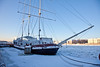 A ship on the Neva river frozen in dock for winter. Saint Petersburg, Russia.