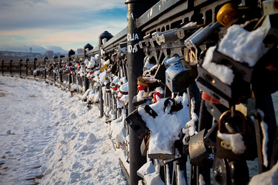 It's a tradition for couples to lock a padlock onto the fence along the waterfront for good luck in their relationship. Irkutsk, Siberia.