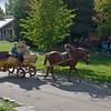 Horse-drawn carts supply rides to residents and to tourists<br /> at Mandrogi Village.<br /> September 17, 2011