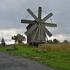 Windmill on Kizhi Island - moved from nearby village to this outdoor museum.<br /> It can be rotated to face the wind and grind the rye and barley grown here.<br /> Bells of the chapel behind were rung as demonstration.<br /> September 18, 2011