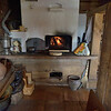 Traditional stove, hearth, and samovar in Mandrogi Village.<br /> September 17, 2011