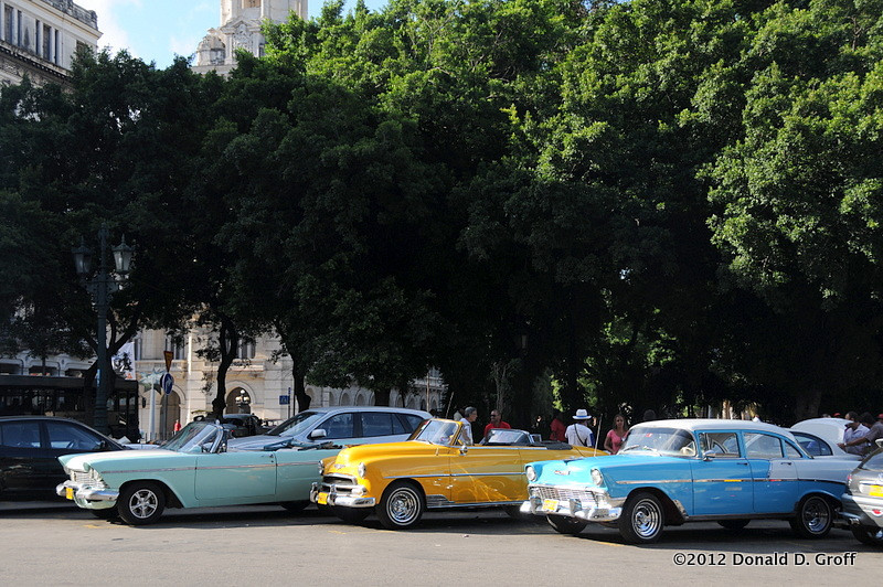 Polished antique cars from the pre-Castro glory days sit on the edge of Parque Central, beckoning to tourists in search of a stylish tour of the city.
