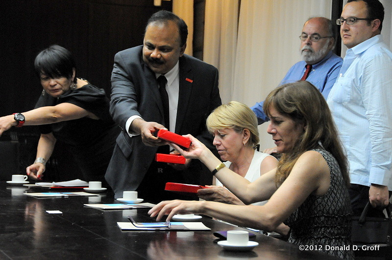 Business Dean Jai Ganesh distributes gifts for giving to the University of Havana officials.