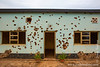 Bullet Holes in Wall of Monument to Belgian Soldiers Murdered at Beginning of Genocide