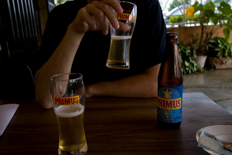 Waiting out the rain with a Primus (national beer of Rwanda)