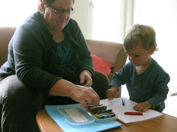 kai and granny drawing together.
