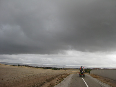 dyon riding into maclaren vale with dark clouds all around