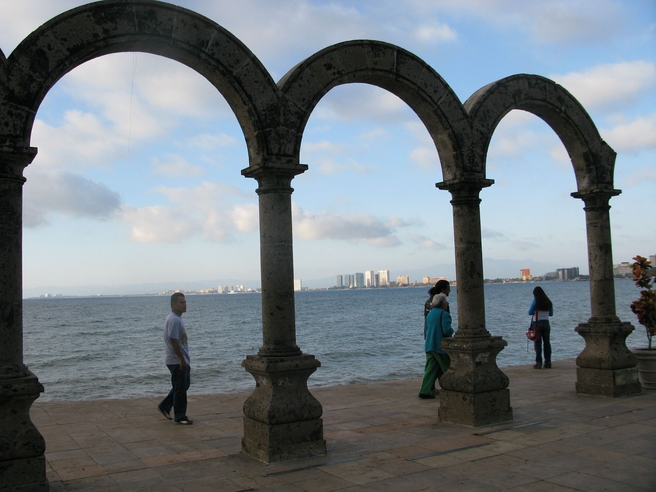 My first evening, strolling along the Malecon, seeing Nuevo Vallarta framed in the aches of the Romantic Zone.