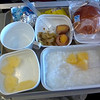 Rice porridge, a pickled egg and some pineapple. (Air China flt.101 to HKG)