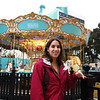Julie poses in front of the Tiffany's carousel