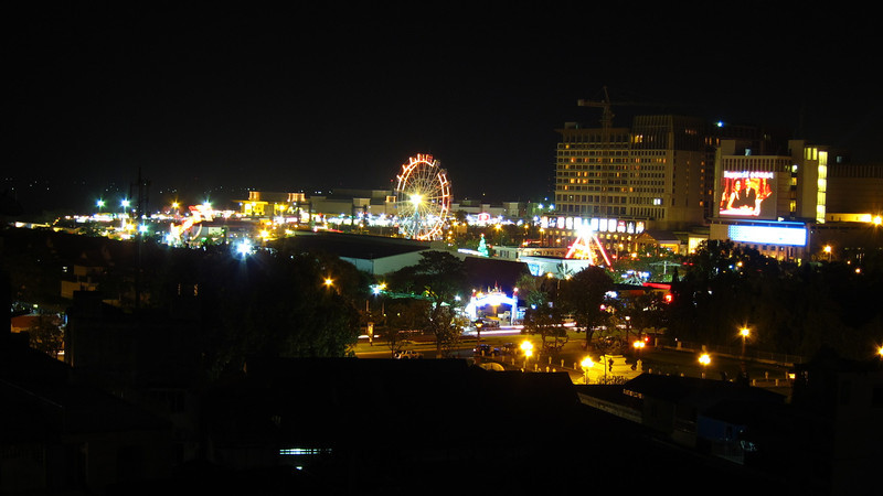 An amusement park is visible from our hotel rooftop. The vibrancy of Phnom Penh is evident as soon as we arrive.
