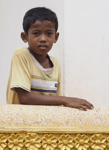 Boy at a temple in Sihanoukville, Cambodia