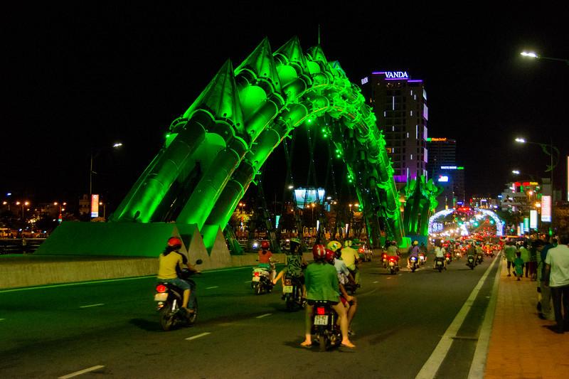 The dragon bridge in Da Nang, Vietnam, with lights that change its color--green. May 2015. [Da Nang 2015-05 039 Vietnam]