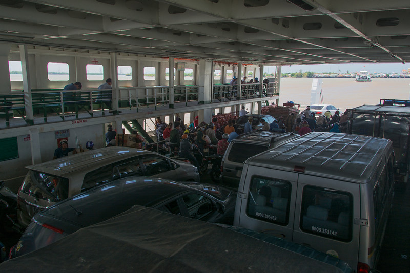 A ferry conveys cars, trucks and motorbikes across the Mekong River, Vietnam, May 2015. [Ho Chi Minh City 2015-04 031 Vietnam]