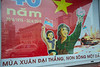 Vietnam is celebrating 40 years as a nation. As with this sign, there are many new things integrating with the old. Ho Chi Minh City (Saigon), Vietnam, May 2015. [Ho Chi Minh City 2015-04 014 Vietnam]