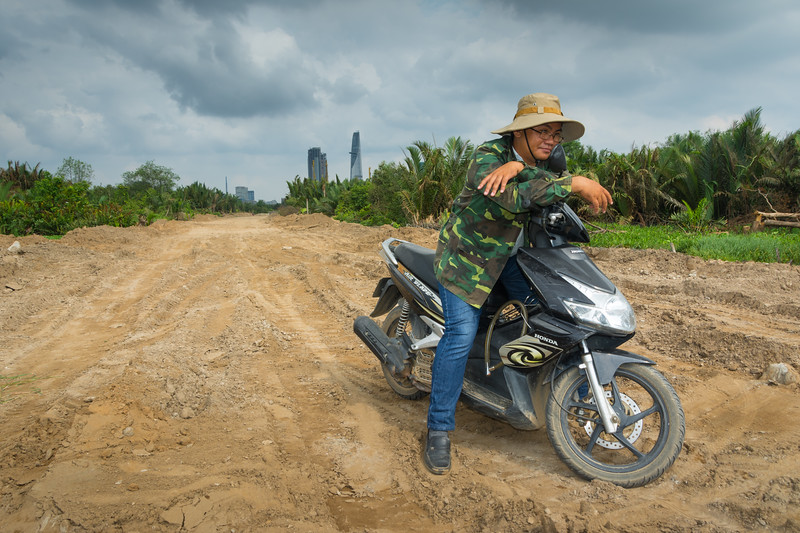 Construction project manager, bird lover and birdwatcher, reflecting on the demise of the city's mangrove wetlands to business developments, Ho Chi Minh City (Saigon), May 2015. [Ho Chi Minh City 2015-05 056 Vietnam]